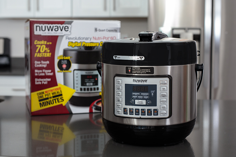 NuWave Pressure Cooker on a kitchen counter after being removed from the box.