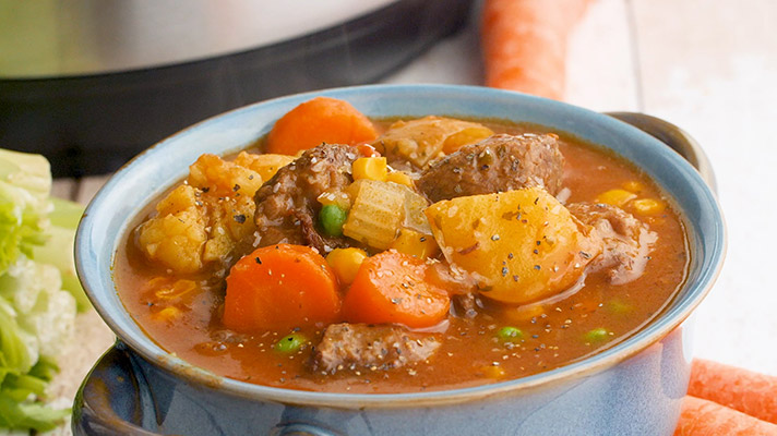 Pressure cooker beef stew in a bowl and ready to serve.